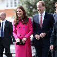 Kate Middleton lors de sa dernière mission avant l'accouchement, le 27 mars 2015, avec le prince William dans le sud de Londres.