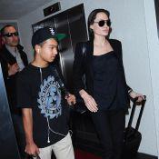 Angelina Jolie, le visage fermé et de retour de New York, soutenue par Maddox