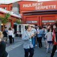"""Illustration - Soirée """"Grand Fooding S. Pellegrino"""" au marché Paul Bert Serpette à Saint-Ouen, le 6 juin 2015."""