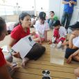 Les onze écoliers lauréats du concours Snapper pour tous organisé par la fondation Princesse Charlene de Monaco et l'Institut océanographique monégasque, le 10 juin 2015, lors de leur sortie en mer à bord du Yerson, qui leur a permis de voir des dauphins.