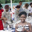 Michelle Obama s'est rendue au Village Camp Ederle de Vicence, en Italie, le 19 juin 2015