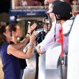 Caroline de Hanovre et Charlotte Casiraghi félicitent les vainqueurs de la Pro Am Cup lors du Jumping International de Monaco, le 26 juin 2015