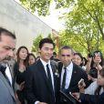 Li Yifeng à la sortie du défilé de mode masculine Dior printemps-été 2016 au Tennis Club de Paris le 27 juin 2015.