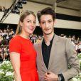 Pierre Niney et Natasha Andrews - Défilé Dior Homme printemps-été 2016 au Tennis Club de Paris le 27 juin 2015.