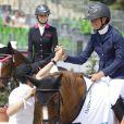 Guillaume Canet félicite sa nièce Paloma de Crozals qui a remportée le prix de la Fondation Financière de l'Echiquier lors du Paris Eiffel Jumping du Champs-de-Mars à Paris, le 3 juillet 2015