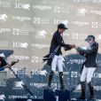 Les gagnants du Grand Prix de Paris : 1er Bertram Allen sur Romanov, 2ème Luciana Diniz sur Fit for Fun 13 et le 3ème Darragh Kenny sur Sans Soucis Z - Remise du Grand Prix de Paris lors du Longines Paris Eiffel Jumping au Champ-de-Mars à Paris, le 4 juillet 2015.