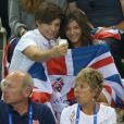 Louis Tomlinson et Eleanor Calder à Londres, lors des Jeux Olympiques, en août 2012.