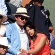 Marion Bartoli et son compagnon lors de la finale masculine des Internationaux de France à Roland-Garros le 7 juin 2015 à Paris