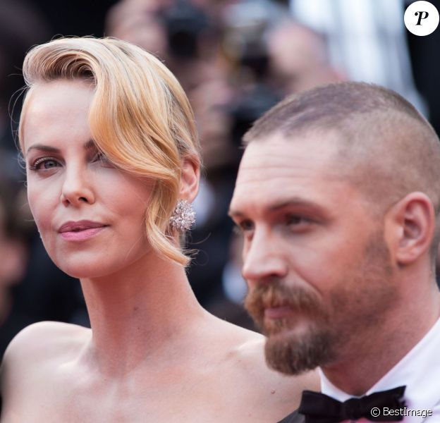 "Charlize Theron, Tom Hardy - Montée des marches du film ""Mad Max : Fury Road"" lors du 68e Festival International du Film de Cannes, le 14 mai 2015."