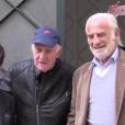 Jean-Paul Belmondo et Rémy Julienne pour son 83e anniversaire, devant chez lui à Paris, le 9 avril 2016.