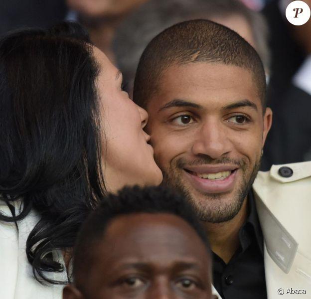 Nicolas Batum et sa compagne Aurélie (ici lors de PSG - Reims au Parc des Princes en mai 2015) sont devenus parents d'un petit garçon, Ayden Richard Batum, dans la nuit du jeudi 28 au vendredi 29 avril 2016.