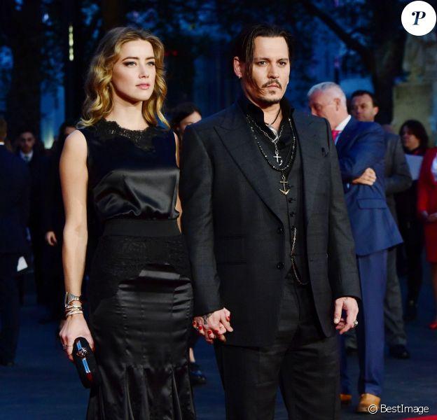 """Johnny Depp et sa femme Amber Heard à l'avant-première du film """"Black Mass"""" lors du Festival BFI à Londres, le 11 octobre 2015."""