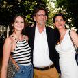 Luc Ferry et sa femme Marie-Caroline Becq Fouquières et leur fille à l'inauguration de la fête des Tuileries organisée par Caroline Barclay le 24 juin 2016. © Coadic Guirec / Bestimage