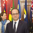 Le président français François Hollande et Ségolène Royal lors d'une session de travail spéciale de la rencontre des chefs de gouvernement du Commonwealth sur le changement climatique à La Valette, le 27 novembre 2015.