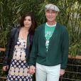 Info - Jean-Marc Barr est papa d'un petit Jude - Jean-Marc Barr et sa compagne Stella - People au village des Internationaux de France de tennis de Roland Garros à Paris, le 1er juin 2014. Pe