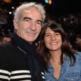 Raymond Domenech et sa compagne Estelle Denis, lors de la finale du BNP Paribas Masters, à Paris le 8 novembre 2015.
