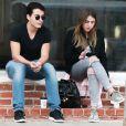Exclusif - Manolo Vergara (le fils de Sofia Vergara) fait une pause cigarette avec une amie dans les rues de Melrose place à West Hollywood, le 11 avril 2016