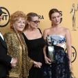 Todd Fisher, Debbie Reynolds, sa fille Carrie Fisher et sa fille Billie Lourd à la press room des SAG Awards à Los Angeles le 26 janvier 2015