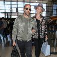 Rosie Huntington-Whiteley et son compagnon Jason Statham arrivent à l'aéroport LAX de Los Angeles pour prendre un avion. Le 23 juillet 2015