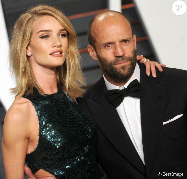 """Rosie Huntington-Whiteley et Jason Statham - People à la soirée """"Vanity Fair Oscar Party"""" à Hollywood. Le 22 février 2015."""