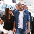 Tony Parker et sa fiancée Axelle Francine se promènent main dans la main pendant leurs vacances à Saint-Tropez, le 1er juillet 2014.
