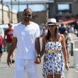 Tony Parker et sa fiancee Axelle Francine se promenent main dans la main pendant leurs vacances a Saint-Tropez, le 20 aout 2013.