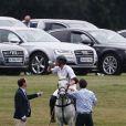 Le prince Harry prenait part le 6 mai 2017, sous le regard de sa compagne Meghan Markle, à l'Audi Polo Challenge au club de polo de Coworth Park à Ascot.