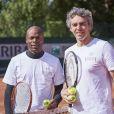 Sylvain Wiltord et françois Trillo lors de la deuxième journée du Trophée des Personnalités de Roland-Garros le 7 juin 2017.