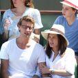 Ana Girardot et son compagnon Arthur de Villepin - People dans les tribunes lors de la finale des Internationaux de tennis de Roland-Garros à Paris, le 6 juin 2015.
