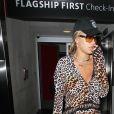 Rita Ora porte un ensemble léopard à son arrivée à l'aéroport de LAX à Los Angeles, le 1er août 2017
