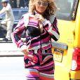 Rita Ora porte un ensemble jogging très coloré à la sortie de son hôtel à New York, le 17 juillet 2017