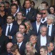 Laurent Delahousse, Guy Martin et sa femme Katherina Marx, Olivier Royant, Carla Bruni - Sorties des obsèques de Mireille Darc en l'église Saint-Sulpice à Paris. Le 1er septembre 2017
