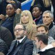Nagui et sa femme Mélanie Page - People au match de football France-Biélorussie au Stade de France à Saint-Denis le 11 octobre 2017. © Cyril Moreau/Bestimage