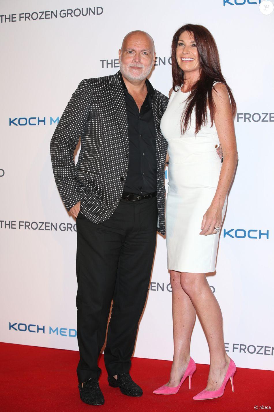 Gary Goldsmith, oncle de Kate Middleton, et sa femme Julie-Ann lors d'une avant-première à Londres en juillet 2013.