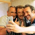 Antoine Duléry, Jean Dujardin, Johnny Hallyday dans le film Chacun sa vie