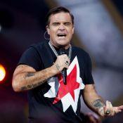 """Robbie Williams """"défoncé"""" chez Bono : une anecdote hilarante !"""