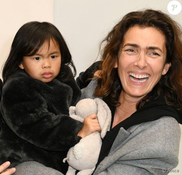 Christine Innamorato, directrice artistique de Bonpoint, Mademoiselle Agnès et sa fille Swan au défilé Bonpoint printempt-été 2018 à Paris, le 24 janvier 2018.