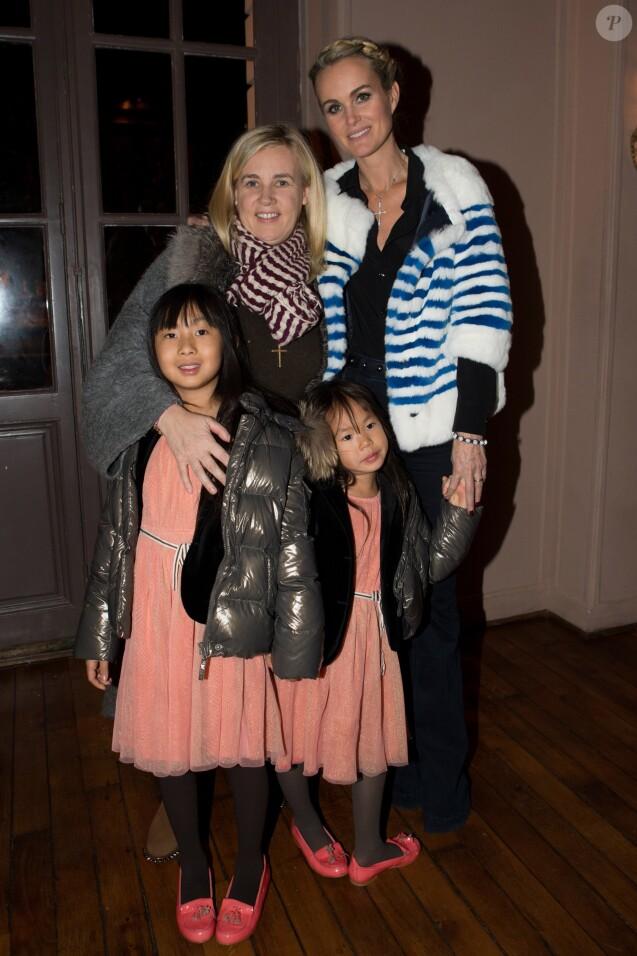 """Exclusif - Laeticia Hallyday, ses filles Jade et Joy, et Helene Darroze, la marraine de Joy et chef etoilee qui est co-presidente de l'association """"La Bonne Etoile"""" - Aftershow apres le concert caritatif de Johnny Hallyday pour l'association de sa femme """"La Bonne Etoile"""", qui vient en aide aux enfants du Vietnam, au Trianon a Paris, le 15 decembre 2013."""