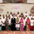 """Le président Emmanuel Macron, accompagné du premier ministre Narendra Modi, rencontre les """"Solar Mamas"""" lors de sa visite en Inde à New Delhi le 11 mars 2018."""