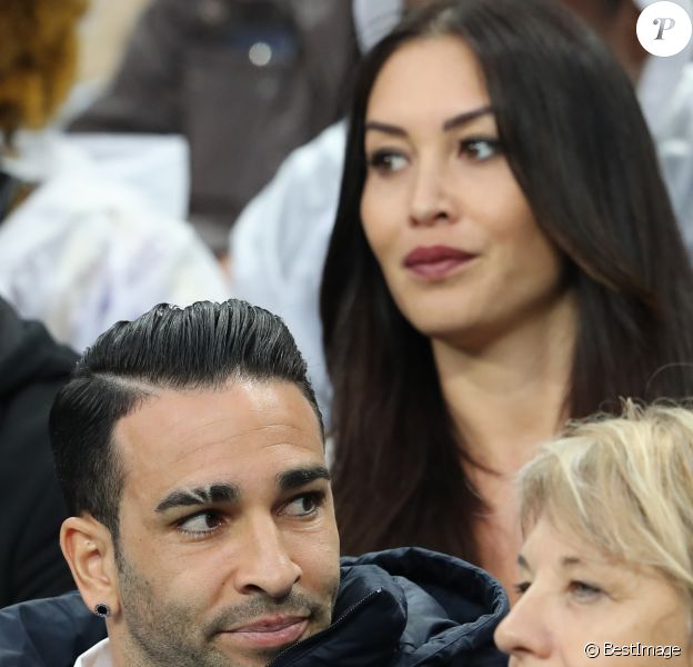 Adil Rami et Sidonie Biémont enceinte lors du match du quart de finale de l'UEFA Euro 2016 France-Islande au Stade de France à Saint-Denis, le 3 juillet 2016. © Cyril Moreau/Bestimage