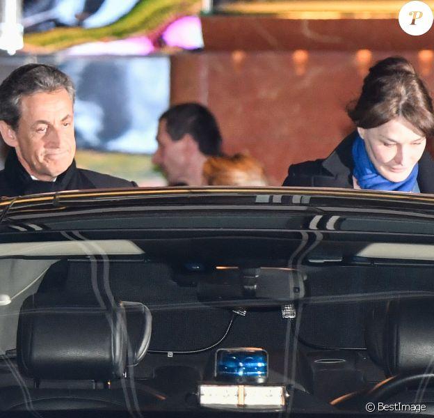 """Nicolas Sarkozy et sa femme Carla Bruni-Sarkozy- Nicolas Sarkozy s'est rendu sur le plateau de TF1 lors du journal télévisé de 20 heures après sa mise en examen puis a été dîner avec sa femme Carla et son équipe dans le restaurant italien de la rue de la Pompe """"Giulio Rebellato"""" à Paris le 22 mars 2018."""