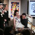 Genviève de Fontenay avec Laurent Baffie, Miss Paris et Pascal Sellem à la vente aux enchères, chez Sotheby's. 30/03/09