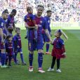 Lionel Messi, Ivan Rakitic, ses filles Adara et Althea et Gerard Piqué avec ses fils Milan et Sasha au stade du Camp Nou lors du match de Liga, le FC Barcelona contre l'Athletic Club à Barcelone, Espagne, le 18 mars 2018.