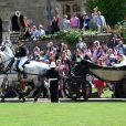 Le prince Harry et Meghan Markle, duc et duchesse de Sussex, ont fait une procession dans le landau Ascot après leur mariage en la chapelle St George à Windsor le 19 mai 2018, à la rencontre du public dans toute la ville de Windsor et le long du Long Walk.