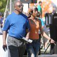 Brandy et son père lors de la fête de l'école de sa fille Sy'rai à Los Angeles