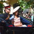 """Le prince Harry, duc de Sussex, et Meghan Markle, duchesse de Sussex - Les membres de la famille royale britannique lors du rassemblement militaire """"Trooping the Colour"""" (le """"salut aux couleurs""""), célébrant l'anniversaire officiel du souverain britannique. Cette parade a lieu à Horse Guards Parade, chaque année au cours du deuxième samedi du mois de juin. Londres, le 9 juin 2018."""