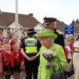 La duchesse de Sussex Meghan Markle effectue son premier déplacement officiel avec la reine Elisabeth II d'Angleterre à Runcorn, Cheshire, Royaume Uni, le 14 juin 2018.