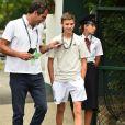 Romeo Beckham à son arrivée au tournoi de Wimbledon le 4 juillet 2018 pour le match de Roger Federer contre Lukas Lacko.