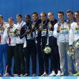 Les médaillés d'argent (Russie), Mehdy Metella, Florent Manaudou, Fabien Gilot et Jérémy Stravius et les médaillés de bronze (Italie) - Les français, médaillés d'or du 4x100m de nage libre lors des championnats du monde de natation à Kazan en Russie. Le 2 août 2015