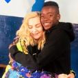 Madonna et son fils David Banda réunis dans l'orphelinat dans lequel elle l'a adopté en 2006 à Mchinji (Malawi). Juillet 2018.
